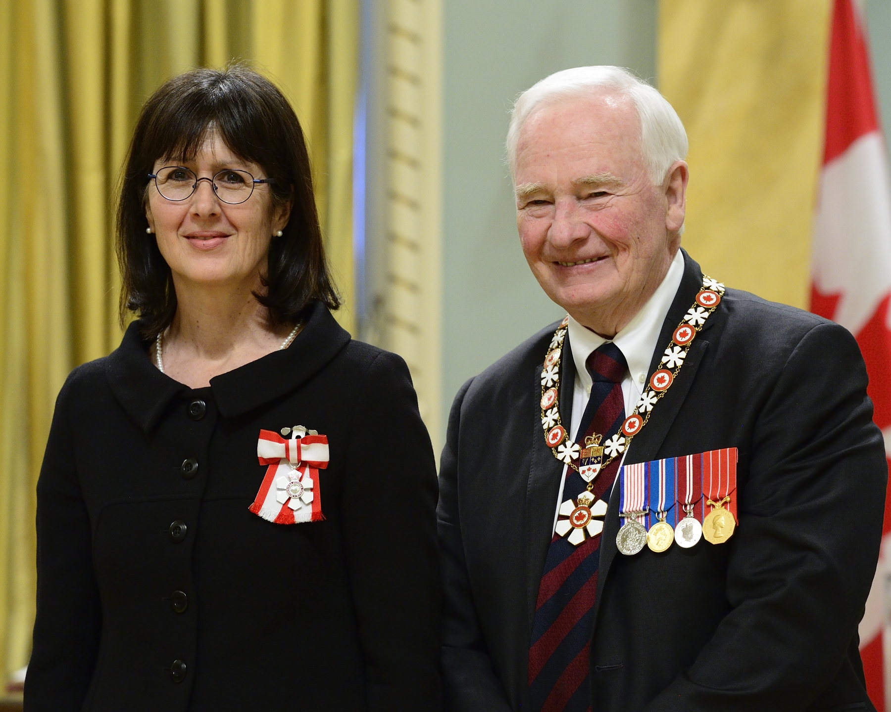 GG05-2017-0029-067 February 17, 2017 Rideau Hall, Ottawa, Ontario, Canada  His Excellency presents the Member insignia of the Order of Canada to Linda Cardinal, C.M.  His Excellency the Right Honourable David Johnston, Governor General of Canada, invested 3 Companions, 11 Officers and 28 Members into the Order of Canada during a special ceremony held at Rideau Hall on February 17, 2017.   The ceremony also marked the official release of the book They Desire a Better Country: The Order of Canada in 50 Stories, a collection of inspiring stories celebrating the 50th anniversary of the creation of the Order.  Credit: Sgt Johanie Maheu, Rideau Hall, OSGG